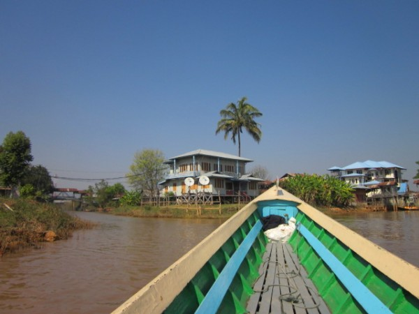 Satellite dishes on the old stilt houses of Inle lake.