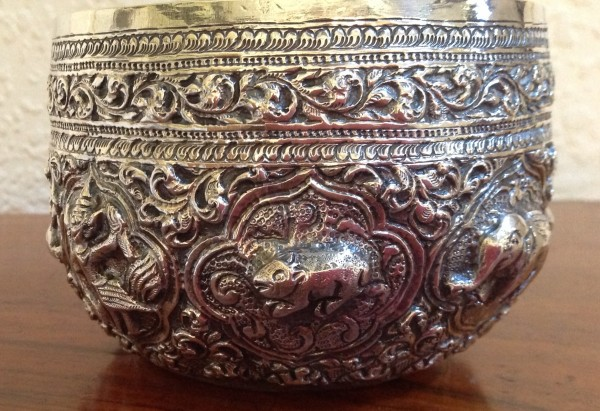 Antique silver libation bowl with the animals of the zodiac. Burma, 1890-1910
